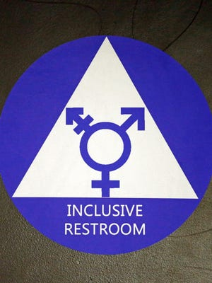 A new sticker designates a gender neutral bathroom May 17, 2016, at Nathan Hale High School in Seattle.