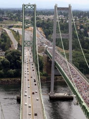 Before the new Narrows Bridge opened to cars, WSDOT allowed people to walk across the new span.