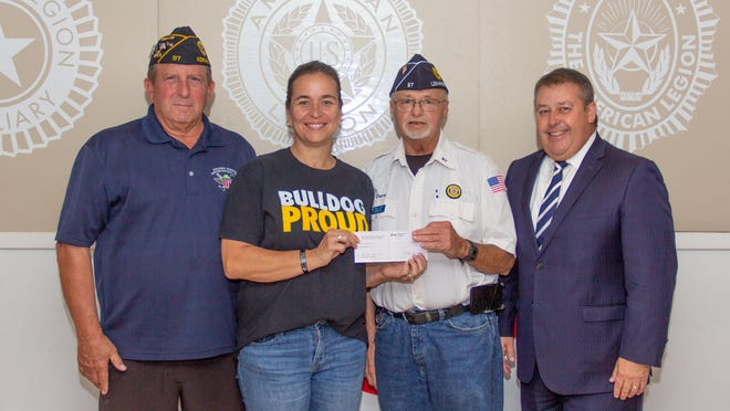 From left, Bill Sanderson, commander of American Legion Post 97, Karri Butler, Marine veteran and Adrian College student, Dave Loop, American Legion District 2 Lenawee County commander and Frank Hribar, AC vice president of enrollment and student affairs.
