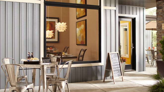 The Ply Gem Mira Woodclad windows have a durable extruded aluminum exterior and a warm, traditional wood interior to complement the homeinside and out.