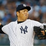 Yankees starting pitcher Hiroki Kuroda delivers in the first inning of Wednesday night's 5-1 win over the Boston Red Sox at Yankee Stadium.