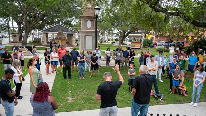 People pray together for unity following the death of George Floyd on the Plaza de La Constitucion in St. Augustine during an event organized by local churches on Friday.