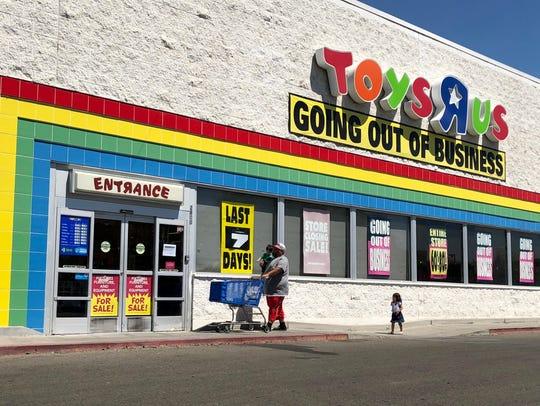 A family enters Visalia Toys R Us on Friday, June 22,