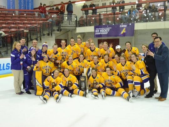 The Elmira College women's hockey team pose with their