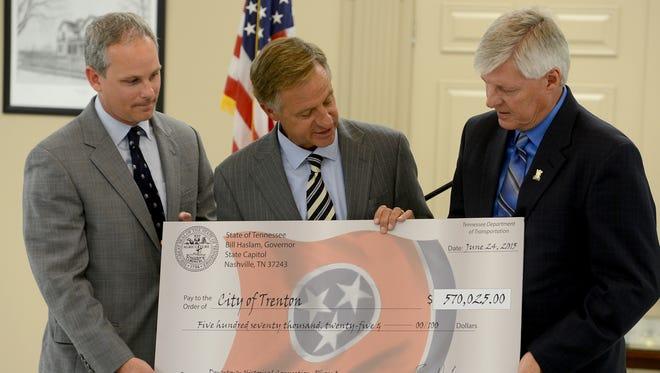 Sen. John Stevens and Gov. Bill Haslam present a check for $570,025 to Mayor Ricky Jackson and the city of Trenton on Wednesday.