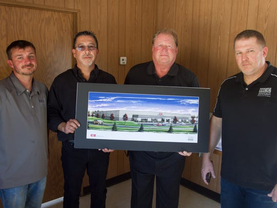 Holding an artist's rendering of the new CZ Cartage facility Wednesday, Sept. 13, 2017, are, from left, Brivar Construction site supervisor Bryan Rosbury, CZ Cartage general manager Eric Boudreau, CZ Cartage co-owner Paul Cornell and Brivar Construction president Craig Stockard. The new site is on East Van Riper Drive in Handy Township.