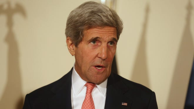 """U.S. Secretary of State John Kerry,  speaks, during a joint press conference in Kabul, Afghanistan, Saturday, July 12, 2014. Kerry says both of Afghanistan's presidential candidates are committed to abiding by the results of the """"largest, most comprehensive audit"""" of the election runoff ballots possible."""""""