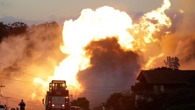 In this Sept. 9, 2010, file photo, a massive fire roars through a mostly residential neighborhood in San Bruno, Calif., following a gas pipeline explosion.