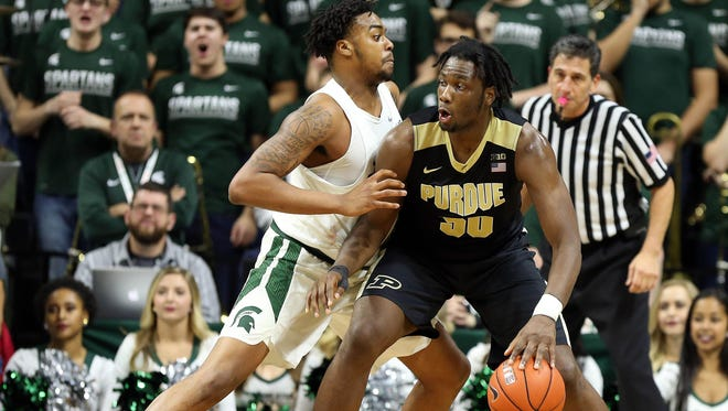 Purdue's Caleb Swanigan, right, scored 25 points and hauled in 17 rebounds during the Boilermakers' win at Breslin Center on Jan. 24.