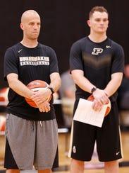 New assistant coach Steve Lutz, left, and graduate
