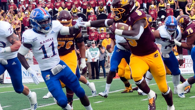 Central Michigan running back Jonathan Ward (5) carries the ball as Kansas safety Mile Lee (11) closes in during an NCAA college football game Saturday, Sept. 8, 2018, in Mount Pleasant, Mich. (Jim Lahde/The Morning Sun via AP)