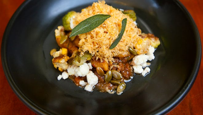 610 Magnolia's butternut gnocchi and smoked lamb ragu with pickled cauliflower, pumpkin seeds, geitost smoked goat cheese and topped with sage leaves. Oct. 3, 2017