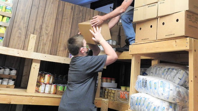 Volunteers Brendon Girouard and Shawn Girard prepare for incoming food at the Winchendon CAC recently. New grants announced by the Community Foundation of North Central Massachusetts will, among other goals, address food insecurity in the region.