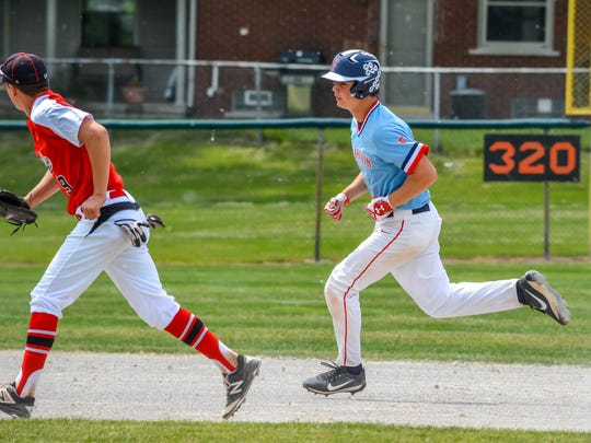 Running out a double in the district final is Livonia Franklin's Jon Montie.