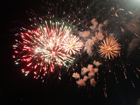 Fireworks light up the night sky during the Town of