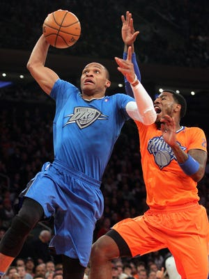 Thunder guard Russell Westbrook goes up for a dunk past Knicks guard Iman Shumpert.