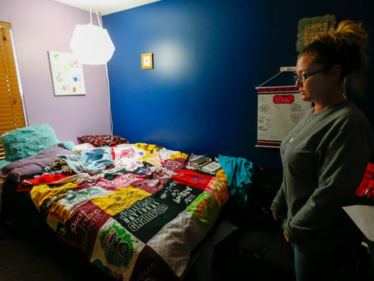 In this file photo, Julie Oziah-Gideon stands in the bedroom of her daughter Samantha Huntley, who died of a heroin overdose on Sept. 3, 2017. Oziah-Gideon will be throwing the first pitch at the Springfield Cardinals game on Aug. 31.
