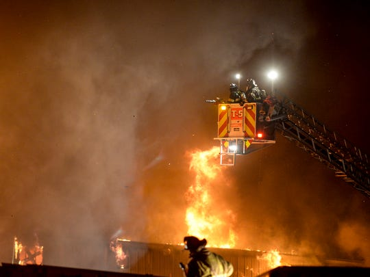 Fire crews from three counties battle a massive blaze at Acorn Design & Manufacturing at 24 Terry Lane in South Londonderry Township on Thursday, Nov. 5, 2015. Water had to be trucked in by tankers to extinguish the blaze that engulfed a 55,000 square foot structure