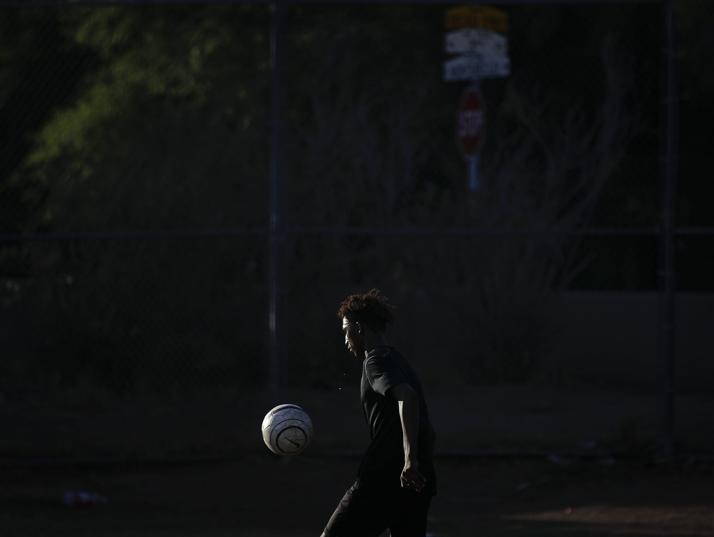 Dawit Ajju practices juggling drills during a morning