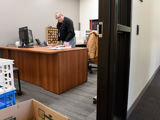 Building official Gary Utsch gets his office organized
