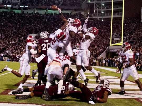 """Alabama defenders including Alabama defensive back Laurence """"Hootie"""" Jones (6) knock down a last second Hail Mary pass by Mississippi State in Starkville, Ms. on Saturday November 11, 2017. (Mickey Welsh / Montgomery Advertiser)"""