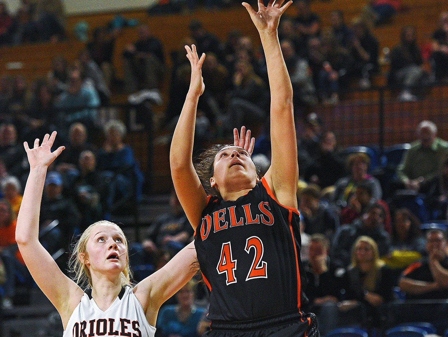 Dell Rapids' Jayda Knuppe (42) goes up for a shot in front of Lennox's Madysen Vlastuin (10) during a 2017 SDHSAA Class A State Girls Basketball Tournament quarterfinal game Thursday, March 9, 2017, at Frost Arena on the South Dakota State University campus in Brookings, S.D.