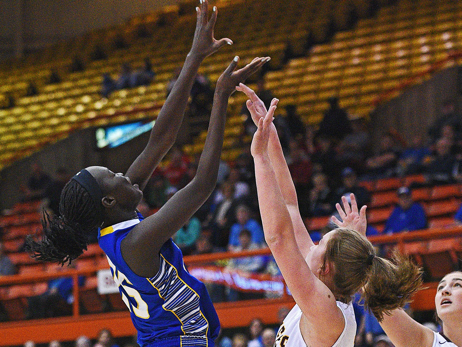O'Gorman's Sebastian Akoi (35) goes up for a shot over Harrisburg's Jeniah Ugofsky (30) during the 2017 SDHSAA Class AA State Girls Basketball championship game Saturday, March 18, 2017, at Rushmore Plaza Civic Center in Rapid City.