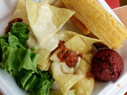 Pulled turkey tamale and spicy queso with chips at