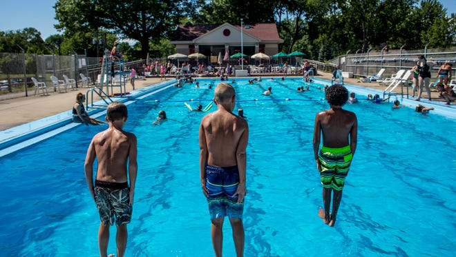 Children line up to take turns jumping into the pool Tuesday, July 26, 2016 at Lion's Field park in Algonac. A $100,000 grant from the Michigan Department of Natural Resources Land and Water Conservation Fund is is helping to fund a new parking lot and drop-off area near the pool, new pickleball and basketball courts, two pavilions, horseshoe pits, benches and walkways.