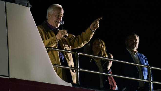 U.S. Sen. John Cornyn, R-Texas, left, is joined by U.S. Sen. Ted Cruz, R-Texas, right, during a campaign event Monday night in Dripping Springs.