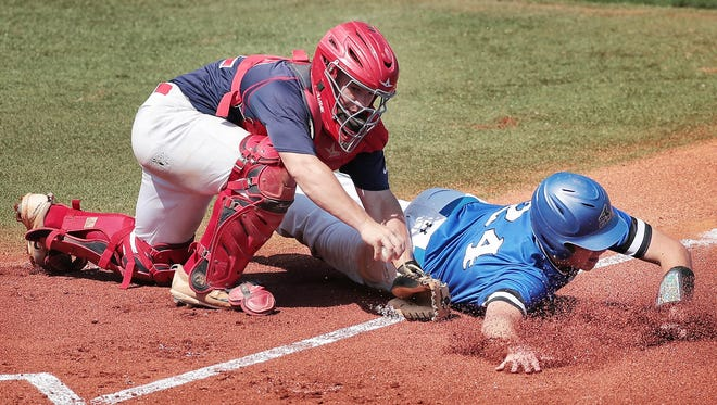 Tipton-Rosemark catcher Alex Langford tags out Christian Academy of Knoxville's Cole Campbell during their Division II Class A finals game at MTSU during the Spring Fling state tournament Thursday.