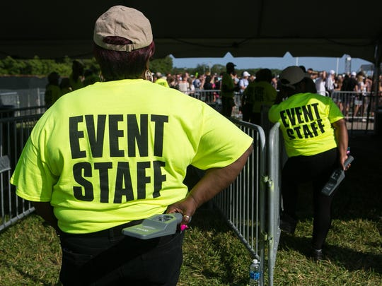 Security personel wait to scan fans as they begin to roll in for the Firefly Music Festival which kicks off Thursday at The Woodlands in Dover.