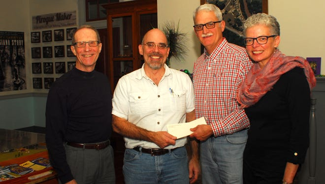 Shown presenting a $21,000 donation to the NAP project are (L to R): Warren A. Perrin, Dr. Mark Rees, Alan Broussard and Brenda Broussard.