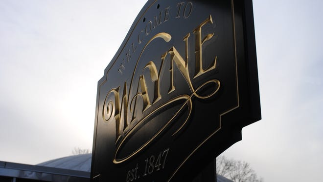 "A hand-carved ""Welcome to Wayne"" sign posted outside Wayne Town Hall on Valley Road. It is one of 74 signs and among the newest, being constructed in 2015."