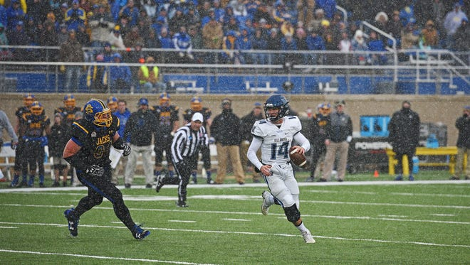 Villanova quarterback Zach Bednarczyk (14) looks for an open receiver as SDSU's Kellen Soulek (94) closes in during playoff game Saturday, Dec. 3, 2016, at Dana J. Dykhouse Stadium on the SDSU campus in Brookings, S.D.