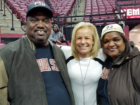 John Pride, left, smiles with FSU women's basketball