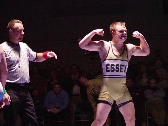 Essex's Jack Carney flexes after winning at 170 pounds