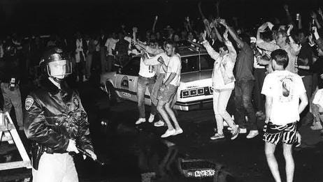 Rioters threw beer bottles at responding police officers during the last College Days in 1987.