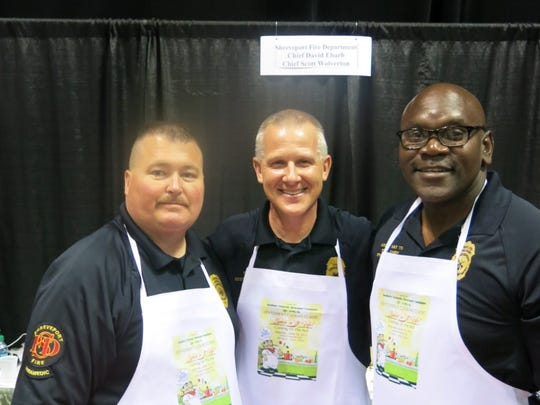 At the Shreveport Fire Department Booth at Cooking Classic: Safety Chief Skip Pinkston, Shreveport Fire Chief Scott Wolverton and Assistant to the Fire Chief Fred Sanders served pulled pork and cole slaw with Sweet Baby Ray Salsa.