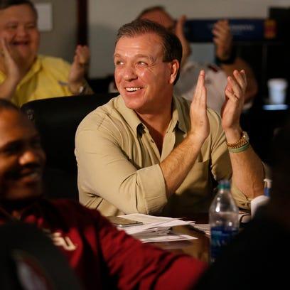FSU Head Coach Jimbo Fisher celebrates after hearing