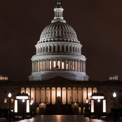 The U.S. Capitol is seen before dawn Wednesday. Congress