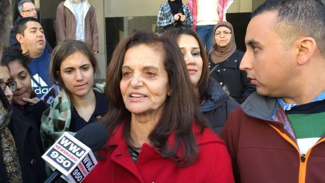 Rasmieh Odeh talks to reporters outside federal court in Detroit after she was found guilty Nov. 10.