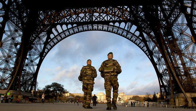 French soldiers patrol at the Eiffel Tower which remained closed on the first of three days of national mourning in Paris on Sunday.  The attacks spurred Mississippi agencies to be on the lookout for possible threats in the state.