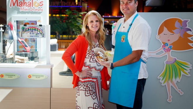 Julie Nitchie and Troy Schall own Mahalo's Mini Donuts at Jordan Creek Town Center. They came up with the idea while vacationing in Hawaii.