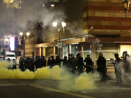 Phoenix police open fire with gas on protesters after a rally by President Donald Trump at the Phoenix Convention Center on Aug. 22, 2017.