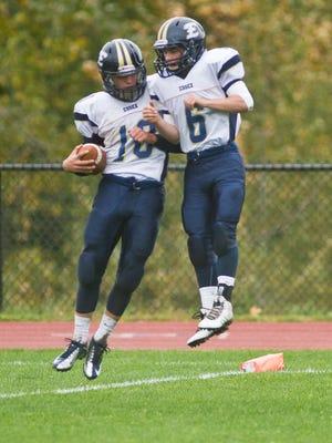 Essex High School's Brendan Gleason, left, and Cody Greene celebrate Gleason's touchdown run during Saturday's game against MMU in Jericho.