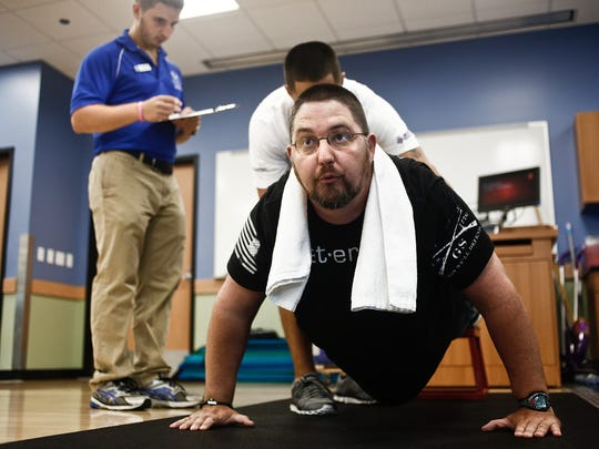 United States Navy veteran Tim Tyler does pushups in Florida Gulf Coast University's exercise science department on Sept. 10, 2014. Tyler is participating in the Warrior Health & Fitness Challenge, a wellness program for veterans.