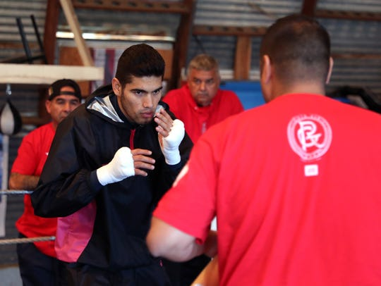 Gilberto Ramirez, of Mexico, works out with trainer