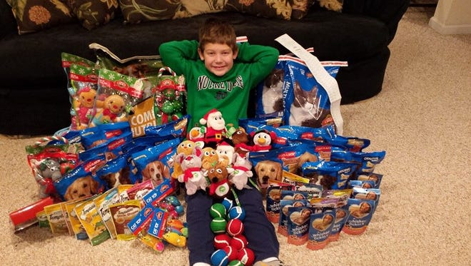 Parker Willman poses with some of the items he's collected for the canines at Kenton County Animal Shelter.