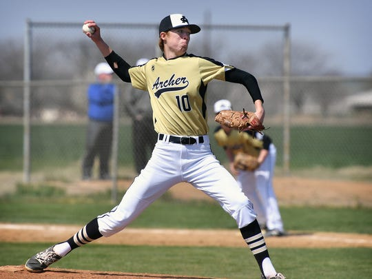 Archer City's Conner Byrd pitches against the Windthorst Trojans Tuesday afternoon in Windthorst.